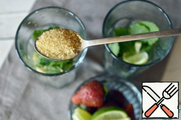 In each glass, pour 1 tsp cane sugar. Good knead with a spoon, you can use a wooden pestle or mortar!