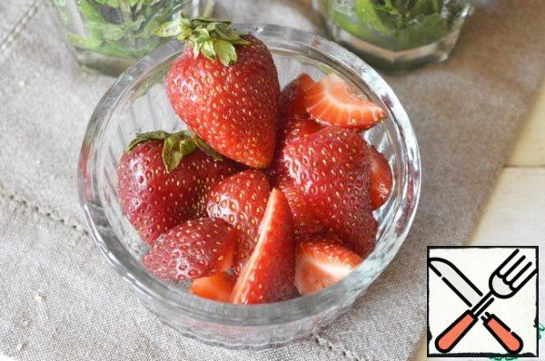 Cut strawberries in halves or quarters-depending on its size!