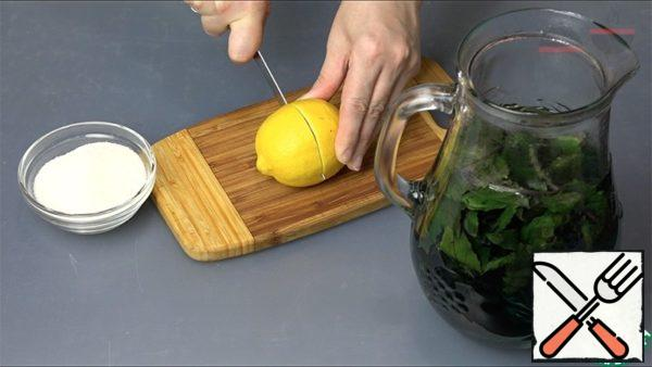 Wash Basil and put in a jug. Pour boiling water over. Let stand for 20 minutes. The water will turn dark purple.