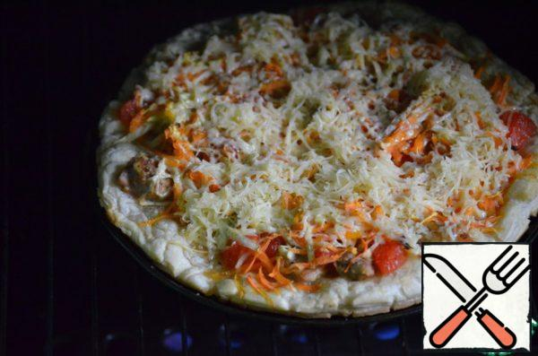 Then remove the pizza, sprinkle with grated cheese and bake for another 10-15 minutes.