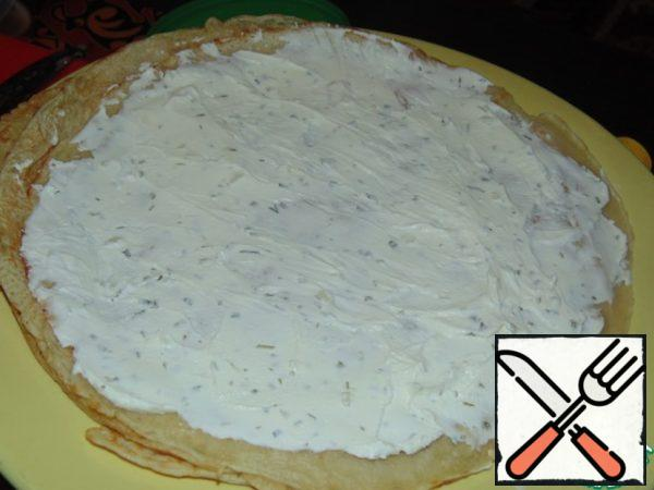 Bake 3 pancakes. Grease each pancake with cottage cheese and herbs.