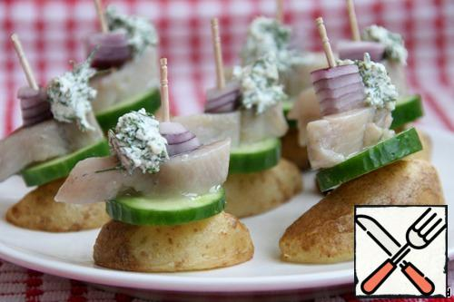 Collect canapes-put cucumber, herring, onion on potatoes, fix with a skewer. On top add a ball from cheese mixture.