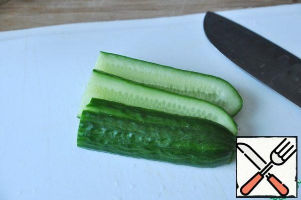 Cucumber cut along the thin strips.