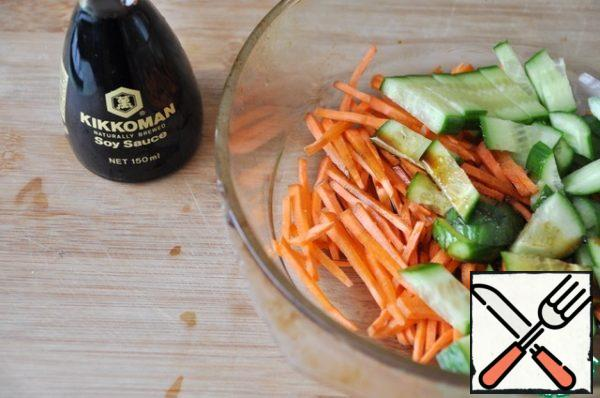 Mix cucumber and carrot, add salt, vinegar and soy sauce.