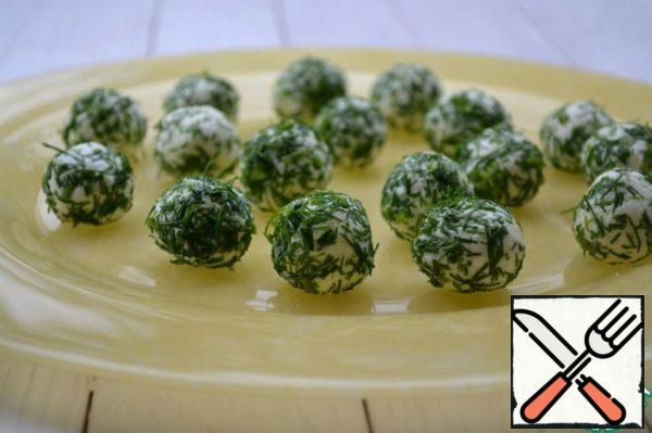 Finely chop the greens, roll cheese balls in it.
