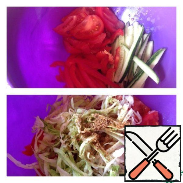 Cucumber and pepper cut into strips, tomato thin half-plates. Chop the young cabbage, add spices.