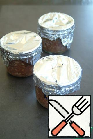 Close the jars with foil.