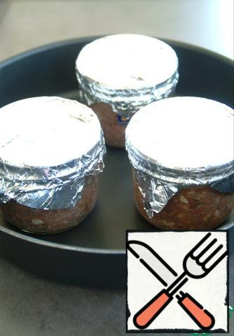 Put in a baking dish. Pour water, water should be up to the middle of the jar. Put in a preheated oven to 180* for 45 minutes.