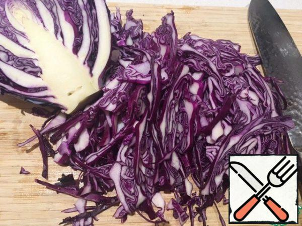 Take a red cabbage and chop/ shred. A bit remember, to cabbage has become a bit softly.