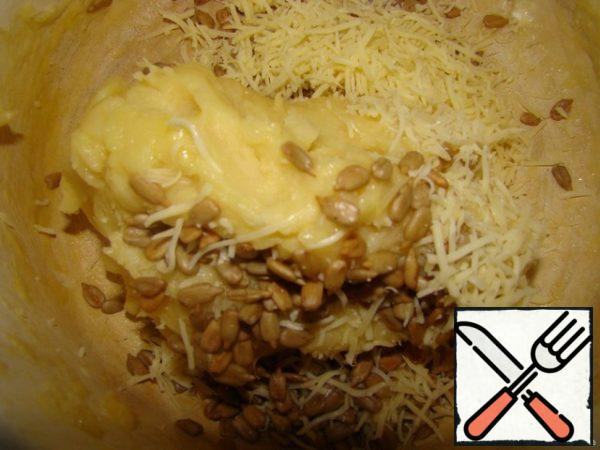 Water with butter and salt bring to a boil Add flour and quickly knead the dough. Let the dough cool slightly add the eggs. Mix well. Add grated cheese and seeds.