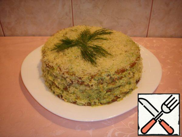 Garnish with grated cheese. Leave overnight in the refrigerator to soak the cakes.