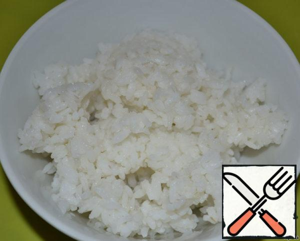 Cook rice and eggs. Finely chop the eggs. All, set them aside, add to the beans at the end.