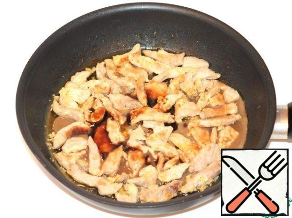 In the pan send pork. Fry until Golden brown over high heat, stirring constantly. Add garlic, soy sauce and sugar to the meat.