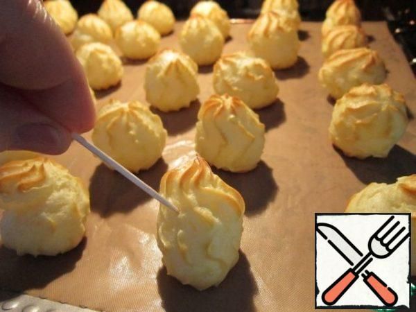 In a preheated 200 degree oven bake 20-25 minutes. For 1-2 minutes until ready to open the oven and gently pierce with a toothpick profiteroles-let off steam. Then bake until tender.