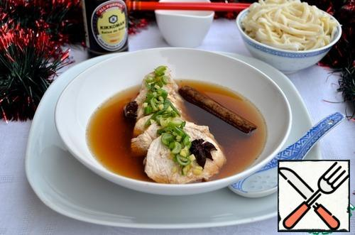 5. Serve in the broth in which it was cooked, adding sesame-ginger dressing. Garnish the noodles.