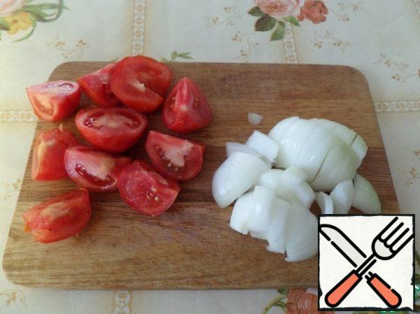 Cut tomatoes and onions.
