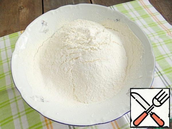 In another bowl sift the flour with baking powder, baking soda and vanilla pudding, add sugar, mix the dry mixture.