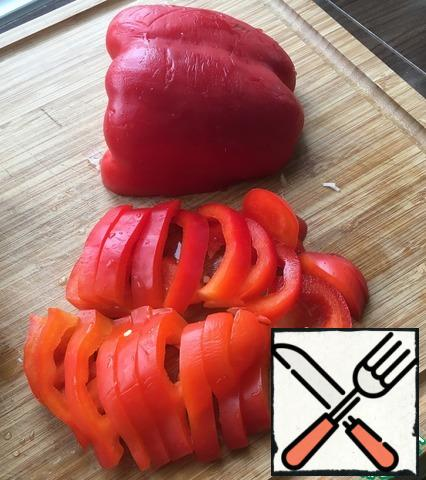Bulgarian pepper should be cut into half rings or as in my case quite large slices.