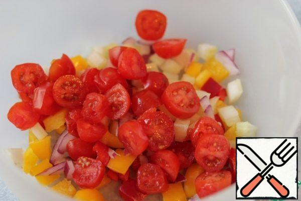 Pepper, onion and celery cut into small cubes, cherry tomatoes cut into halves.