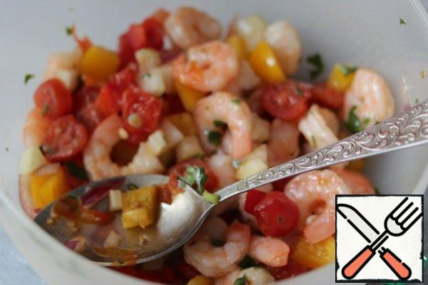 Mix the ingredients for dressing, pour it into the salad, mix. Arrange the salad in portioned bowls or glasses and decorate with whole shrimp.