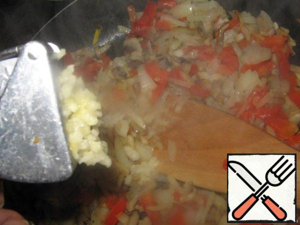 Squeeze the garlic. A little salt and pepper.