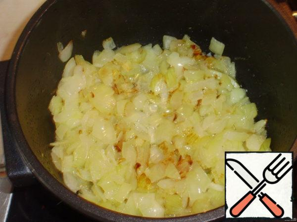 Onions and garlic cut and sauté in oil until transparent.