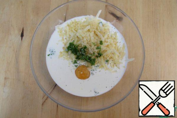 Meanwhile, mix milk, cream, grated cheese, eggs, a little chopped parsley. Salt and pepper to taste.