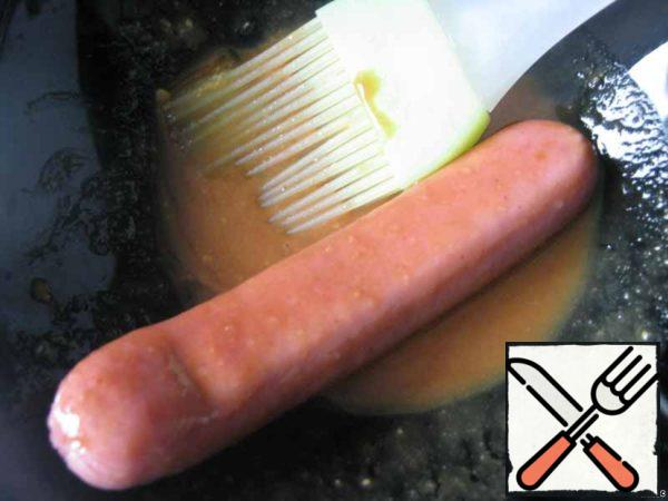 Brush the sausage with marinade.