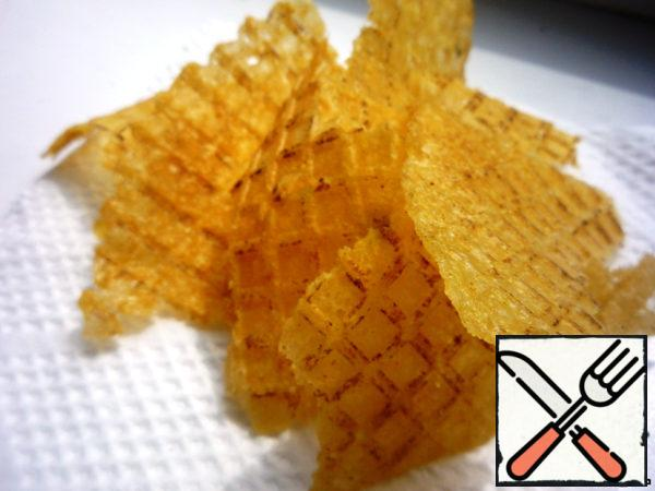 Close the waffle iron and fry. You need to keep a good eye on the chips and time to turn the waffle iron, as chips burn very quickly. When the chips are fried, gently remove from the waffle iron and cut or break into pieces. Top with another sprinkle with salt or paprika.