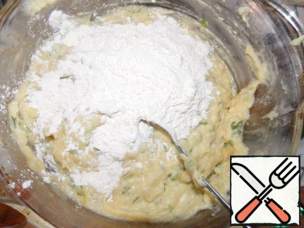 Then add the flour to our dough and mix well.