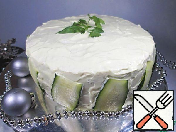Decorate with pieces of cucumber and green leaves.