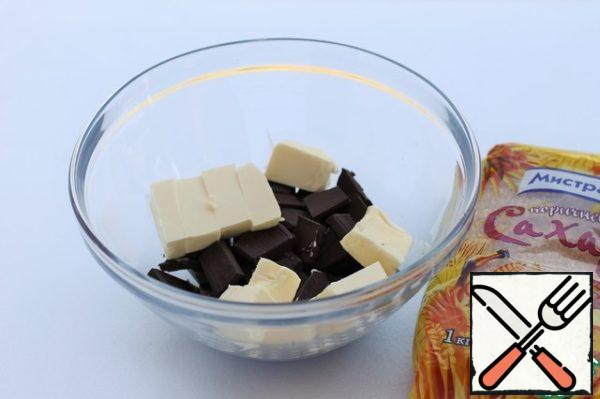 Chocolate break into pieces, cut the butter into cubes. In a water bath melt the chocolate and butter until smooth. Remove from the water bath and add the brown sugar 200 g and vanilla sugar. Mix with a whisk. Give the mass to cool slightly, for 10 minutes.