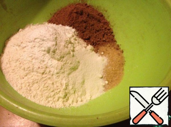 Mix flour with baking powder. Add cocoa, sugar and mix.