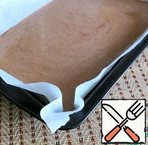 Stir the mixture with a silicone spatula so that the chocolate remaining on the walls of the bowl evenly dispersed in the mass. Pour into a form, covered with parchment. I have it the size of 12*20 cm.