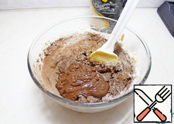 Add the melted cooled chocolate and mix.