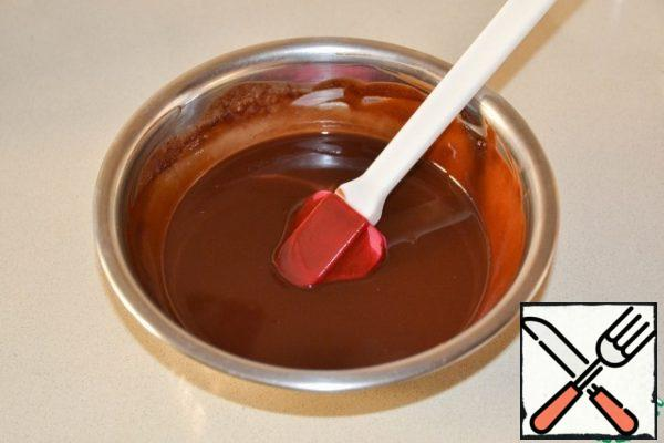 Melt the butter with chocolate in a water bath or microwave.