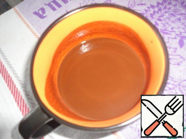 Cocoa powder, coffee and vanilla pour cool boiling water mix well and leave to cool.