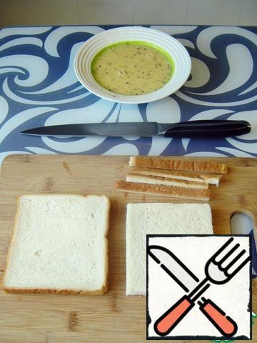 Prepare the bread. Trim the edges with crust.