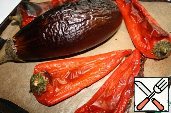 Bake eggplant and peppers. Poke eggplant with a knife. I baked for about 45 minutes at temperature 200 degrees.