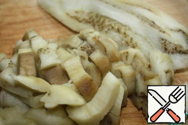 Remove the skin from the eggplant and cut into strips.