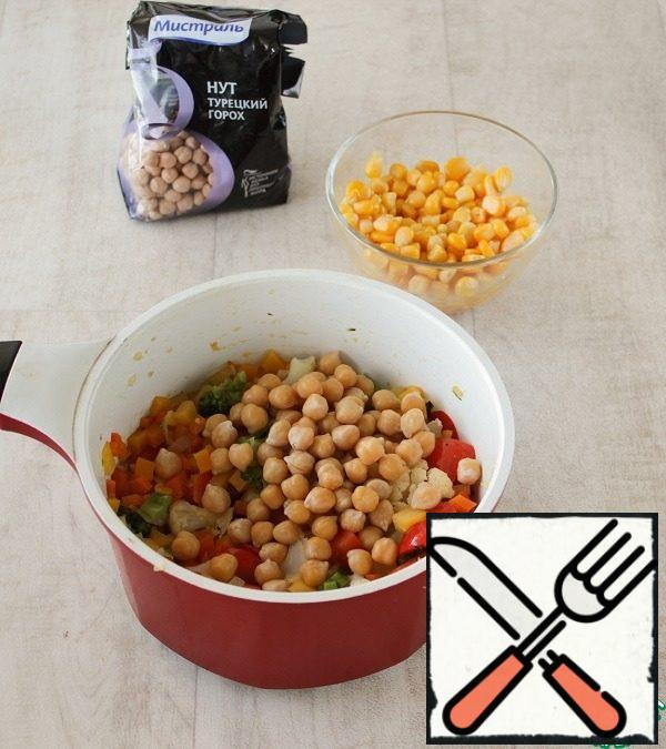 Add to vegetables broccoli and cauliflower, simmer for 5 minutes, then add chickpeas and corn, cook all together for 5 minutes, not forgetting to stir. Then pour boiling water, salt, add curry and bring to readiness. Cover the pan with a towel and let the soup infuse.