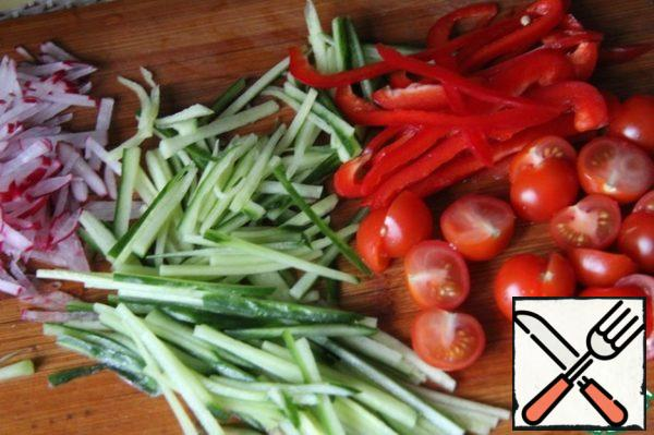 Vegetables cut into thin strips. Cherry in half.