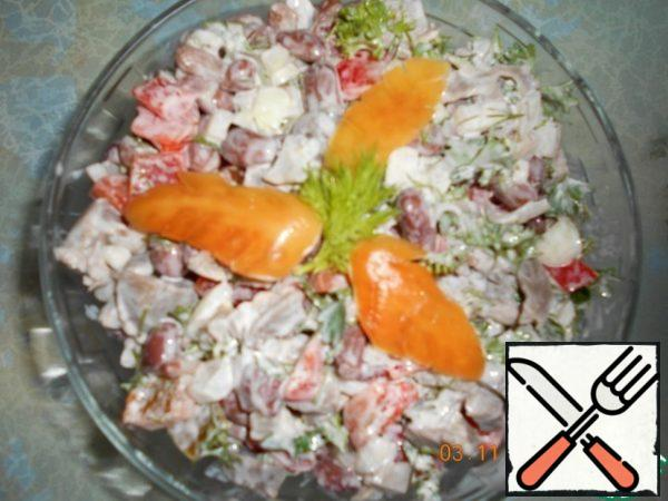 Season the salad with mayonnaise.