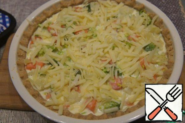 Put in a hot oven (180*C) for 20 minutes. Then remove, sprinkle with grated cheese and again in the oven until ready and Browning cheese.