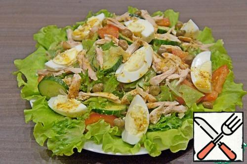Put the salad on top arrange slices of the eggs and pour the remaining dressing.