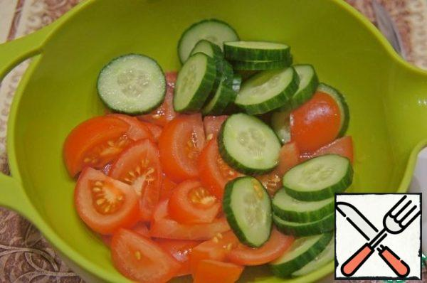Cucumber and tomatoes cut into not too thin slices.