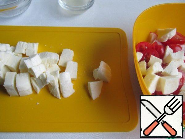 Cut mozzarella into cubes (or randomly) and add to salad bowl.
