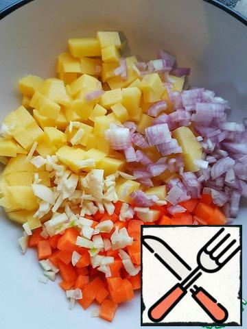 Potatoes and carrots cut into the same cubes, onions and garlic finely chop.