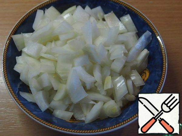 Large onion cut into large pieces.