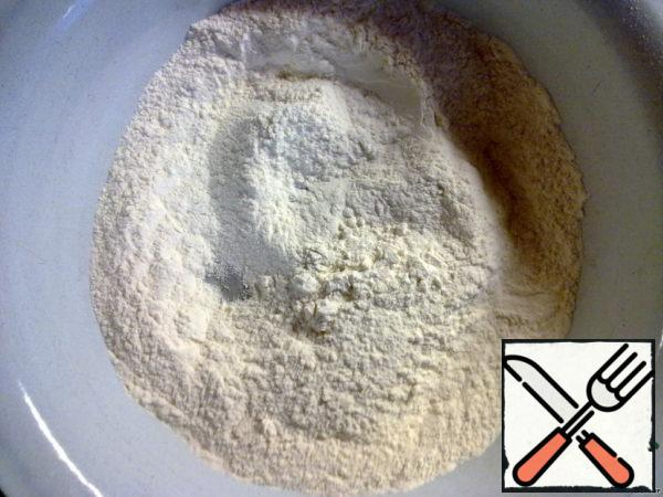 Mix in a Cup of flour, salt and soda.